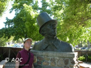 author with a bust of Hans Christian Anderson in Solvang