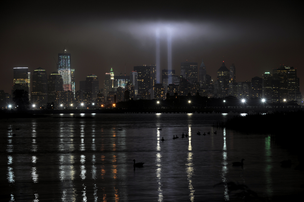 panoramic view of NYC skyline with twin beams of light on the 10th anniversary of 9/11