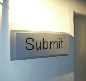 large button reading Submit mounted on the wall
