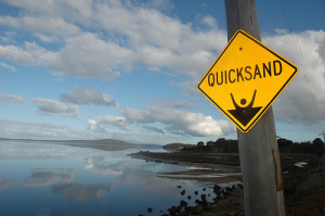 view of a bay with Quicksand sign in the foreground