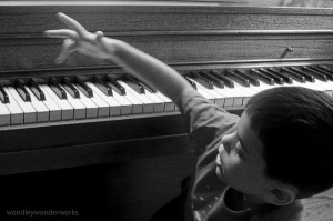 child playing around on piano keys
